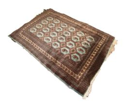 FINELY KNOTTED PAKISTAN BOKHARA RUG, with silky pile and four rows of hexagonal pale blue guls, each