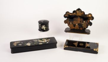 ORIENTAL BLACK LACQUERED PAPIER MACHE LETTER HOLDER, gilt printed with court figures, on an oblong