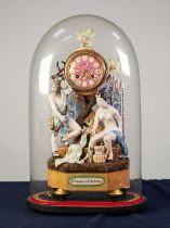 ?DIANA AND ACTOEON? COMPOSITE POTTERY AND WOOD FIGURAL MANTLE CLOCK, the 3? pink porcelain dial with