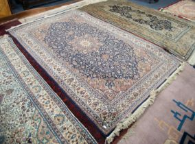 FINE QUALITY PAKISTAN KASHAN PATTERN FINELY KNOTTED RUG with intricate circular petal pattern centre
