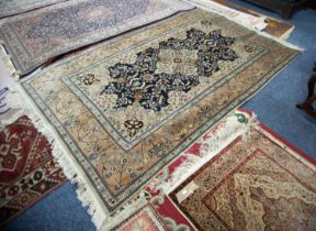 FINELY KNOTTED PAKISTAN 'KASHAN' PATTERN RUG with quatrefoil petal pattern medallion with pendants