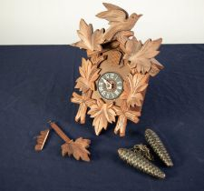 POST WAR SWISS CARVED SOFT WOOD CUCKOO WALL CLOCK, of chalet form with pine cone pattern weights