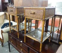 A PAIR OF BAMBOO BEDSIDE TABLES WITH WOVEN CANE PANELS, DRAWER AND UNDER PLATFORM AND INSET GLASS