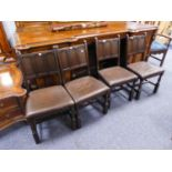 A SET OF FOUR COMMONWEALTH STYLE DINING CHAIRS WITH FRAMED THREE-PANEL BACKS, STUFFED OVER SEATS