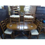 AN ERCOL D-END EXTENDING DINING TABLE WITH FOLD-AWAY LEAF AND SIX MATCHING DINING CHAIRS (4 + 2)