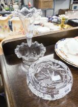 A HEAVY CUT GLASS CIRCULAR ASHTRAY (A.F.) AND A GLASS TABLE CENTRE TRUMPET FLOWER RECEIVER WITH