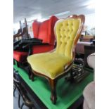 A VICTORIAN STYLE MAHOGANY FRAMED NURSING CHAIR WITH GOLD BUTTON BACK FABRIC