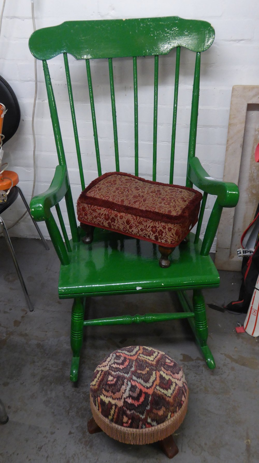 A GREEN PAINTED HARD WOOD COMB-BACKED ROCKING ARMCHAIR AND CIRCULAR STOOL (2)