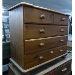 A PINE SMALL CHEST OF TWO SHORT AND THREE LONG DRAWERS, WITH KNOB HANDLES, ON BUN FEET, 2?7? WIDE