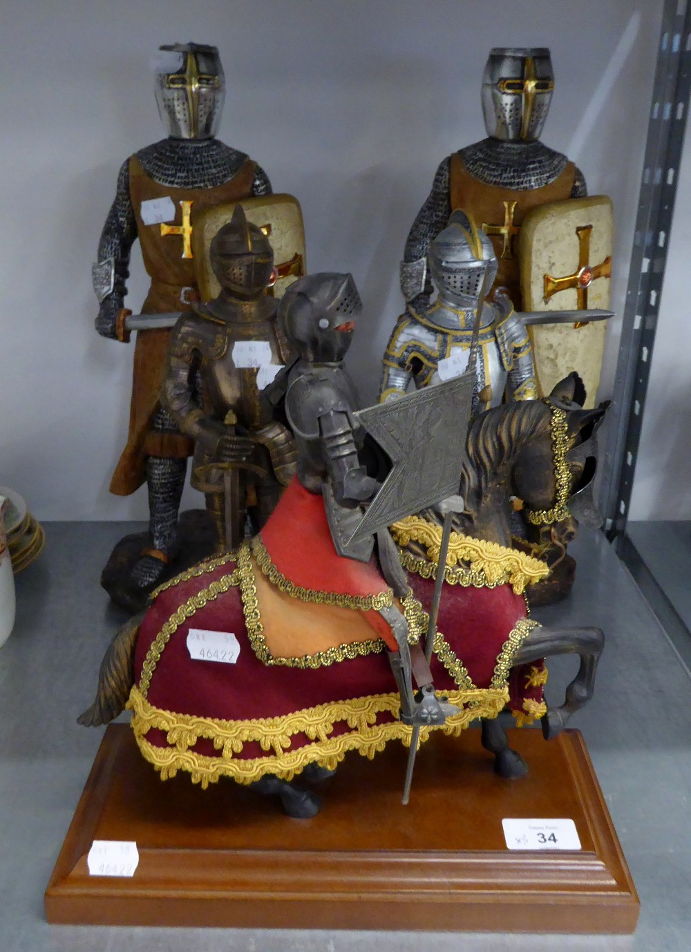 TWO COMPOSITION FIGURES OF CRUSADERS WITH SWORDS AND SHIELDS, 16 ½? HIGH; A RESIN MODEL OF AN