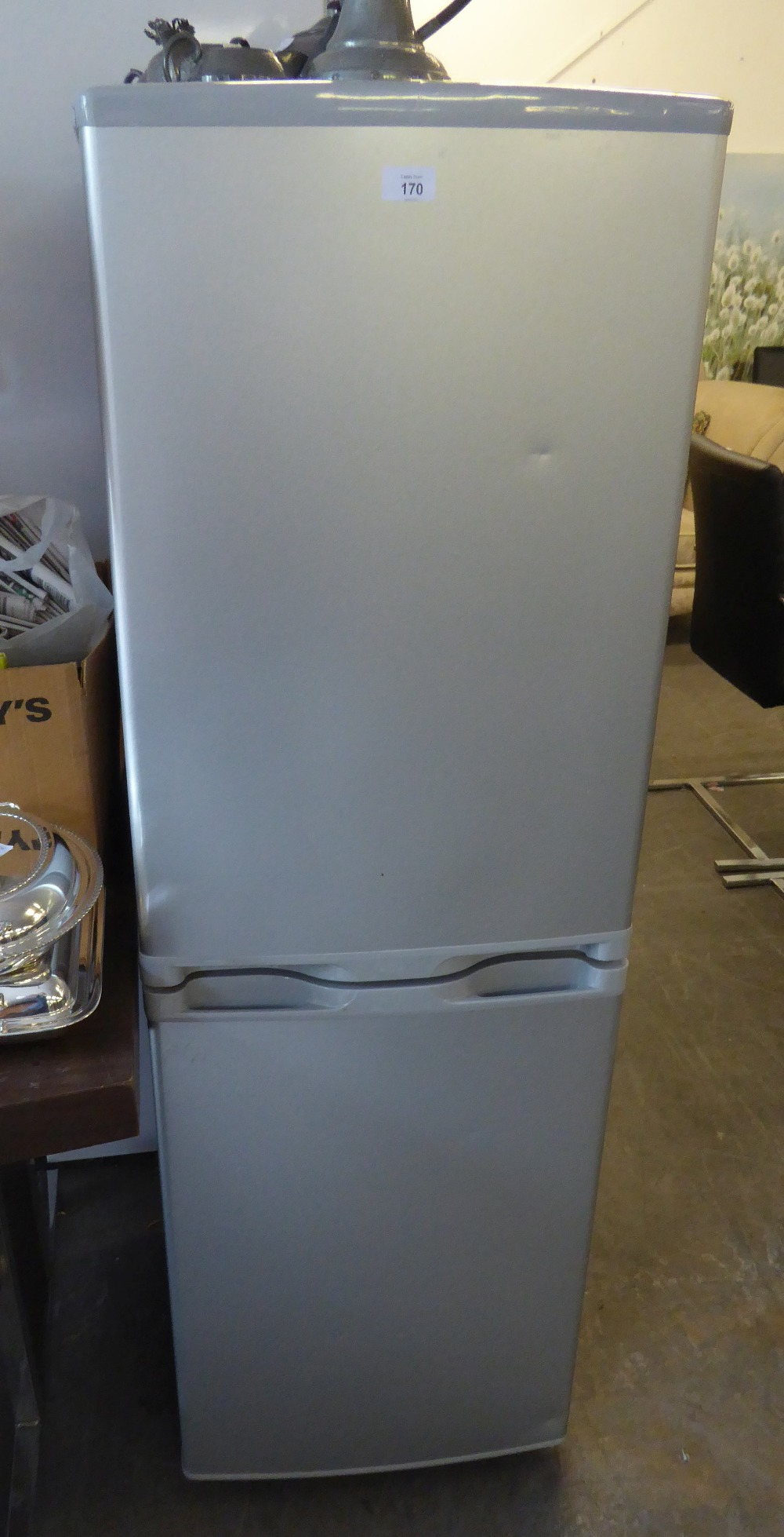 A SMALL FRIDGE FREEZER IN SILVER CASE, THE FREEZER HAVING 3 DRAWERS (SOME DRAWERS CRACKED)