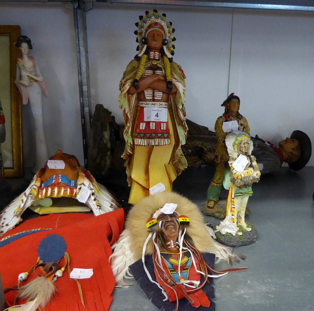 A RESIN STANDING FIGURE OF A COWBOY HOLDING A RIFLE, 20? HIGH (A.F.), TWO NATIVE AMERICAN WALL MASKS