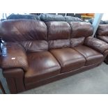 A SOFOLOGY BROWN LEATHER LOUNGE SUITE OF THREE PIECES, VIZ A THREE SEATER SETTEE AND A PAIR OF