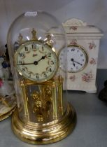 AN ANNIVERSARY CLOCK, UNDER GLASS DOME SHADE AND A POTTERY FLORAL DECORATION CLOCK (2)