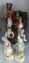 A PAIR OF CHINA FIGURES, SOLDIERS; A PAIR OF BISQUE FIGURES, COURTIER AND LADY; TWO PAIRS OF RESIN