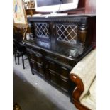 PRIORY BLACK OAK DINING ROOM SUITE OF SIX PIECES, VIZ 4 WHEEL BACK CHAIRS, A REFECTORY DINING