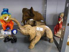 THREE HEAVY SCULPTURAL CLAY MODELS OF ELEPHANTS (3)