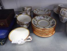 WEDGWOOD CHINA PART TEA SERVICE, ORIGINALLY FOR EIGHT PERSONS, 23 PIECES, WITH FLOWER BASKET
