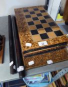 A BOOK FORM BOX, OPENING TO FORM BACKGAMMON AND CHESS BOARDS AND A TOOLED LEATHER FOLDING CHESS