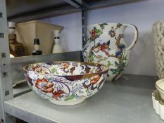 A LARGE FLORAL POTTERY TOILET WATER JUG AND A FLORAL POTTERY FRUIT BOWL (2)