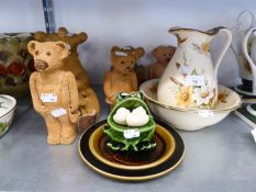 FOUR SCULPTURED CLAY TEDDY BEAR FIGURES; A MODEL OF A POLAR BEAR; A POTTERY SMALL TOILET JUG AND