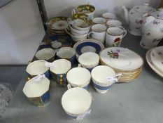 A SET OF FIVE ROYAL DOULTON CHINA OCTAGONALLY PANELLED COFFEE CUPS AND SAUCERS, WITH GILT ON