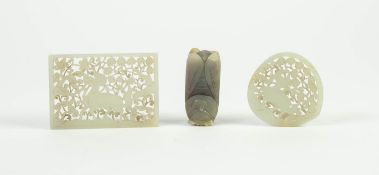 TWO ORIENTAL CARVED AND PIERCED HARDSTONE SMALL PANELS, one oblong, 2 ¾? x 2? (7cm x 5.1cm), the