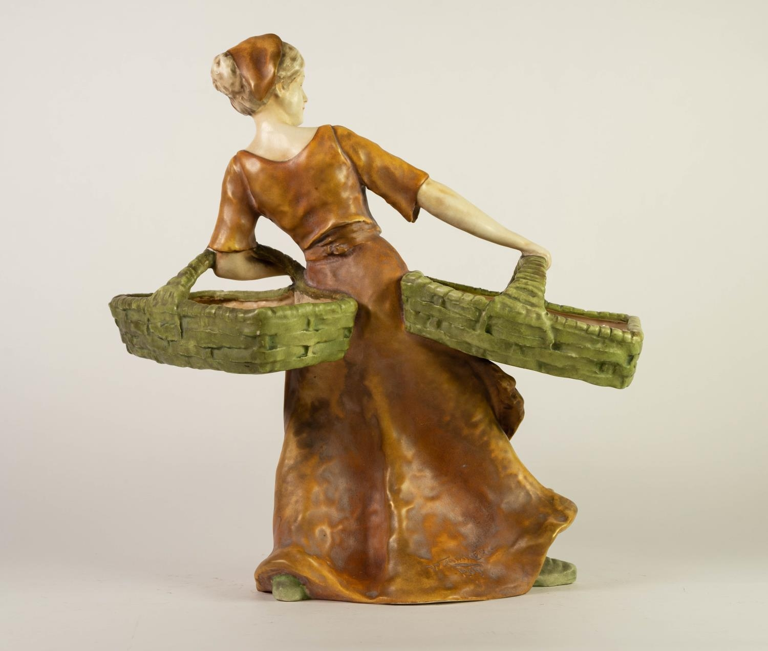 PROBABLY AMPHORA, CHINA FIGURE OF A MAIDEN CARRYING TWO BASKETS, painted in muted tones and gilt, 15 - Image 2 of 3