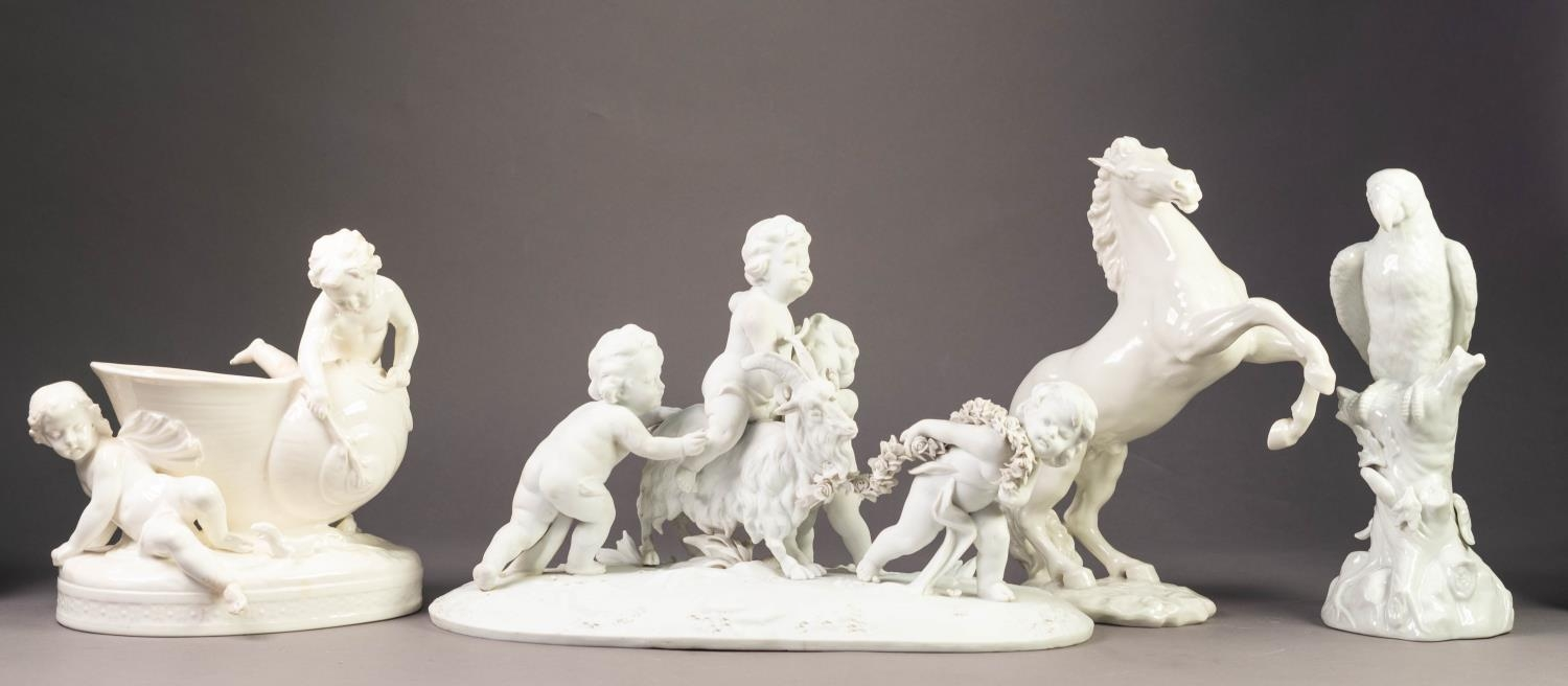 NINETEENTH CENTURY MINTONS WHITE GLAZED RECEIVER GROUP, modelled with snail shell and two putti,