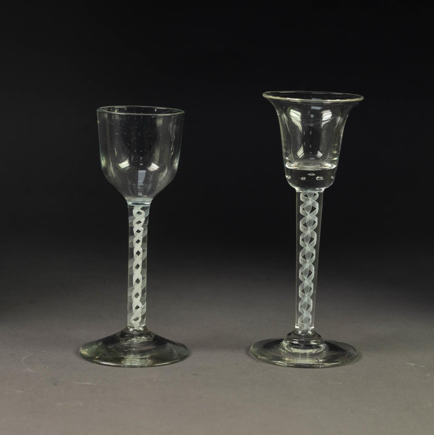TWO OPAQUE TWIST WINE GLASSES, with multi- ply threads, one with bell shaped bowl and plain foot, 6?