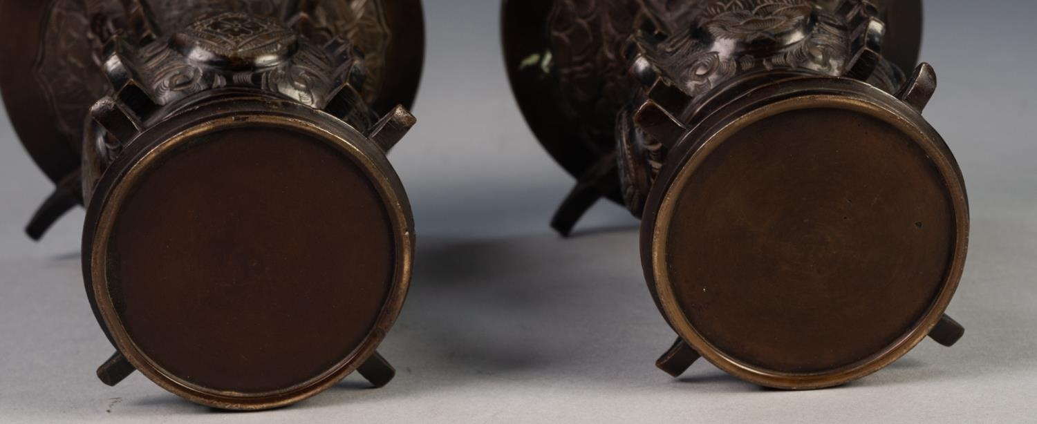 PAIR OF JAPANESE LATE MEIJI PERIOD BRONZE VASES, each of flared form, engraved with panels - Image 4 of 4