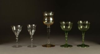 PAIR OF JAMES POWELL STEMMED DRINKING GLASSES, in green with folded foot, 5 ½? (14cm) high, together