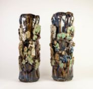 PAIR OF CHINESE LATE QING DYNASTY PROVINCIAL WARE STONEWARE CYLINDRICAL VASES, each sculpted in bold