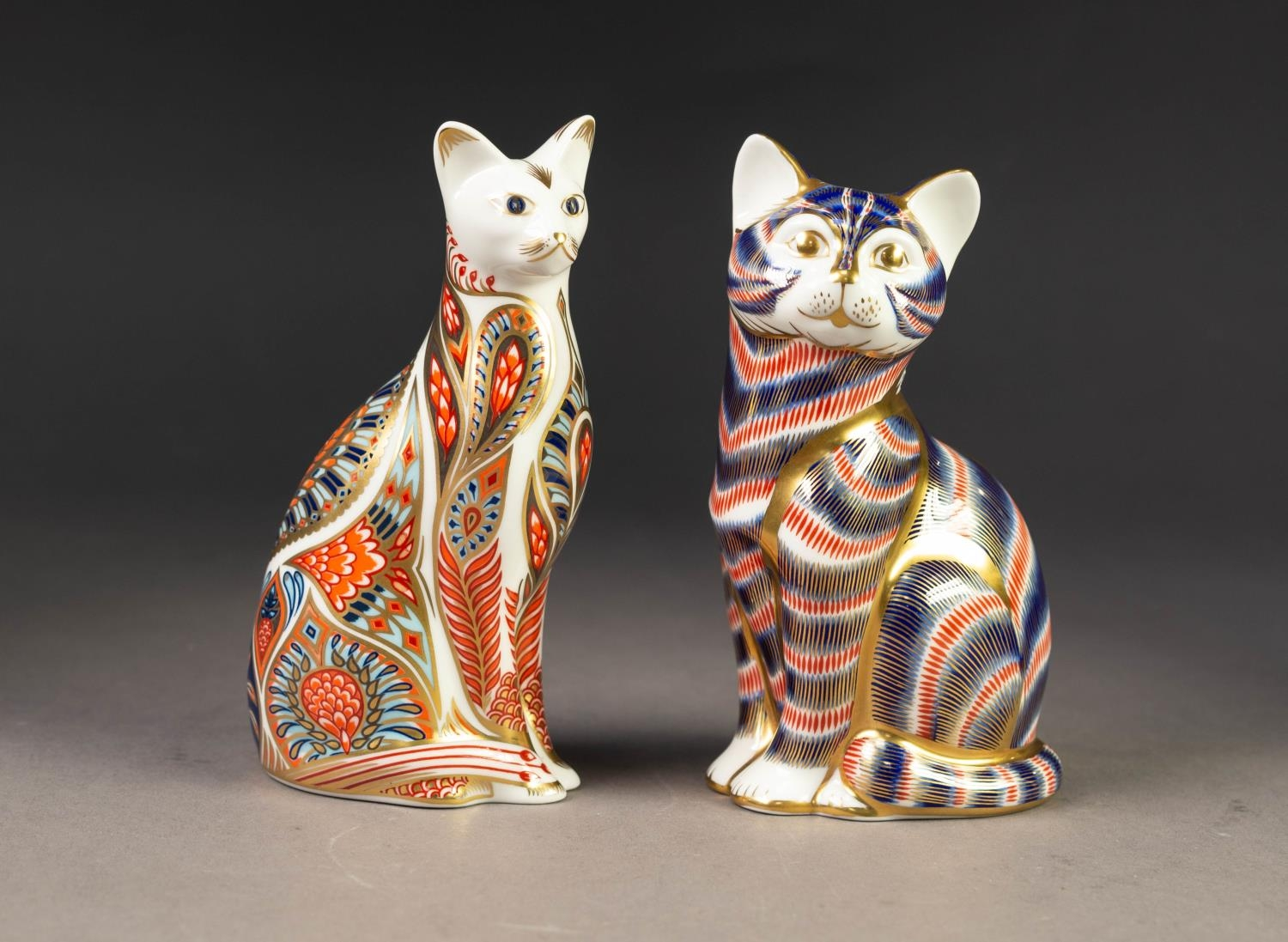 TWO MODERN ROYAL CROWN DERBY IMARI CHINA PAPERWEIGHTS OF CATS, both with gilt stoppers, printed