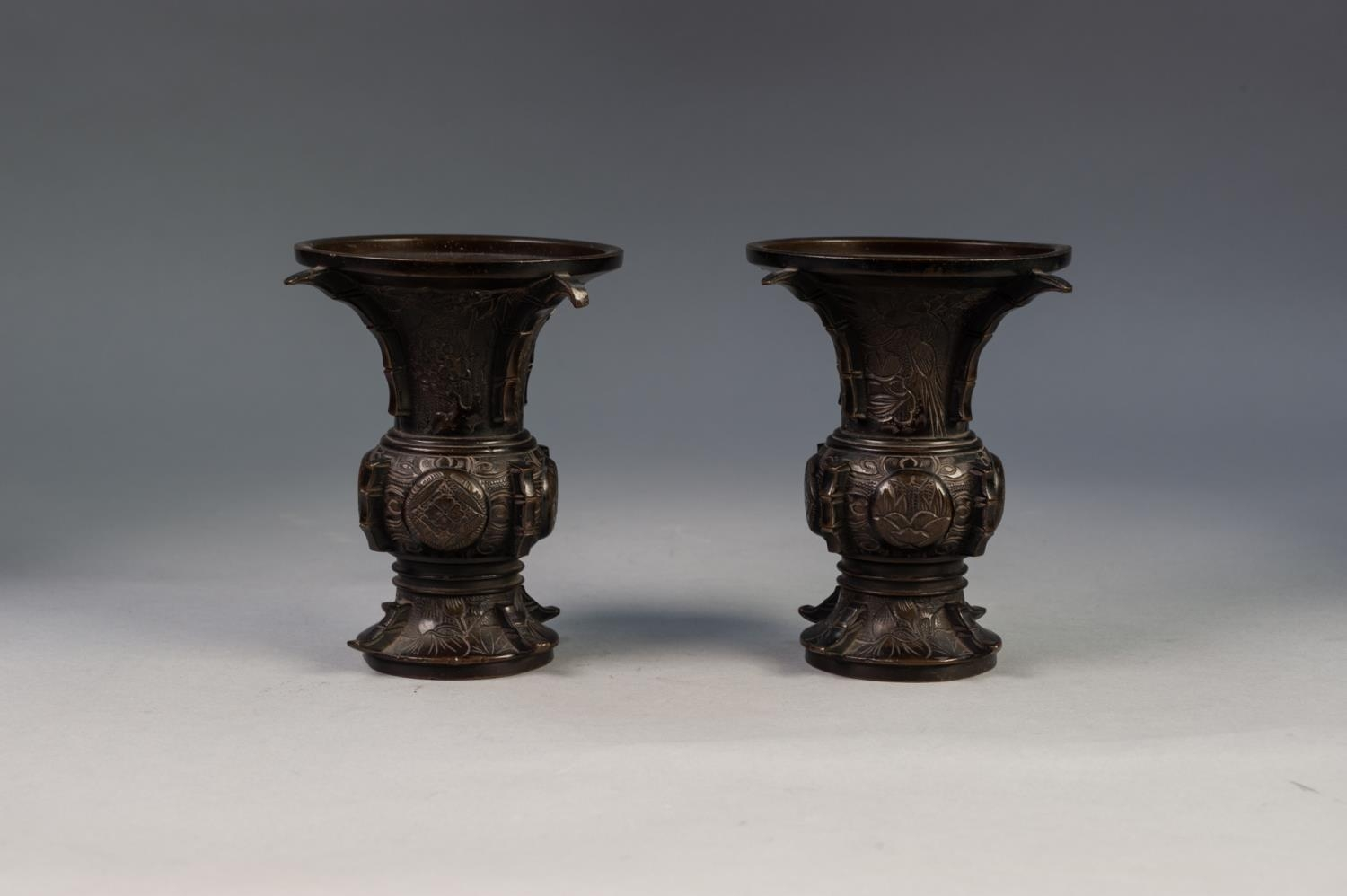 PAIR OF JAPANESE LATE MEIJI PERIOD BRONZE VASES, each of flared form, engraved with panels - Image 3 of 4