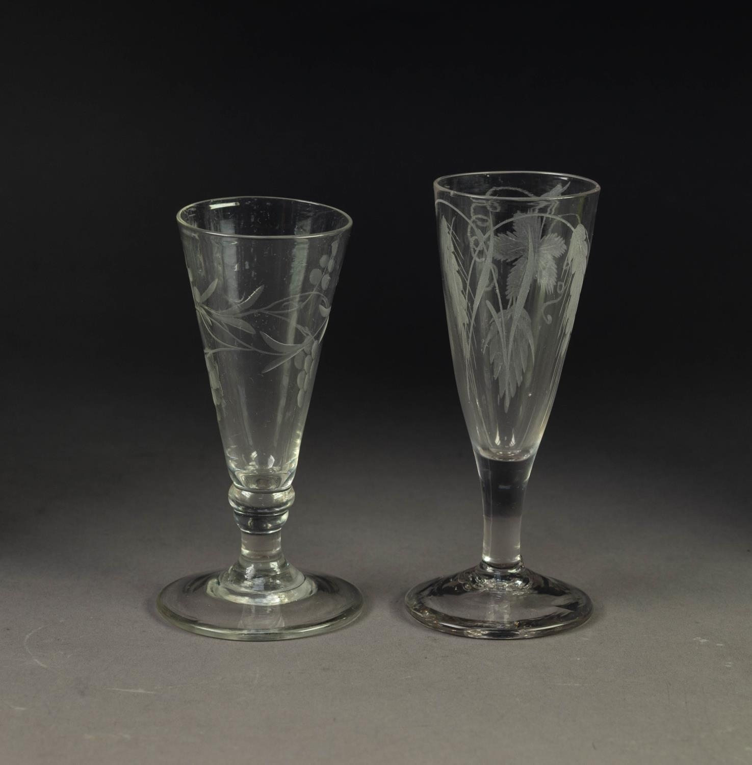 TWO ALE GLASSES WITH ENGRAVED TRUMPET SHAPED BOWLS, each wheel cut with fruiting vines, 6? (15.