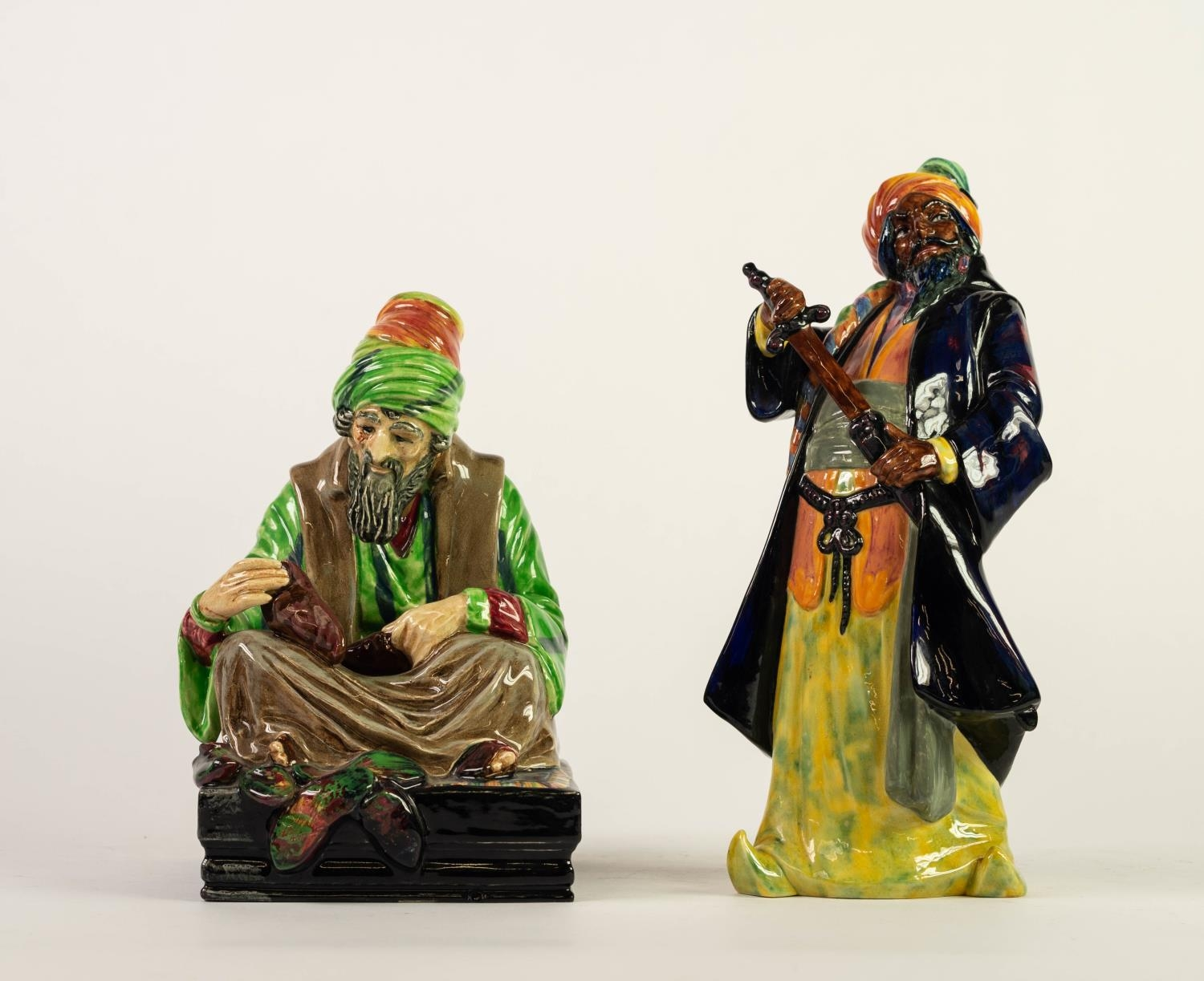 TWO ROYAL DOULTON CHINA FIGURES, ?The Cobbler?, HN1706, 8? (20.3cm) high, and ?Blue Beard?,