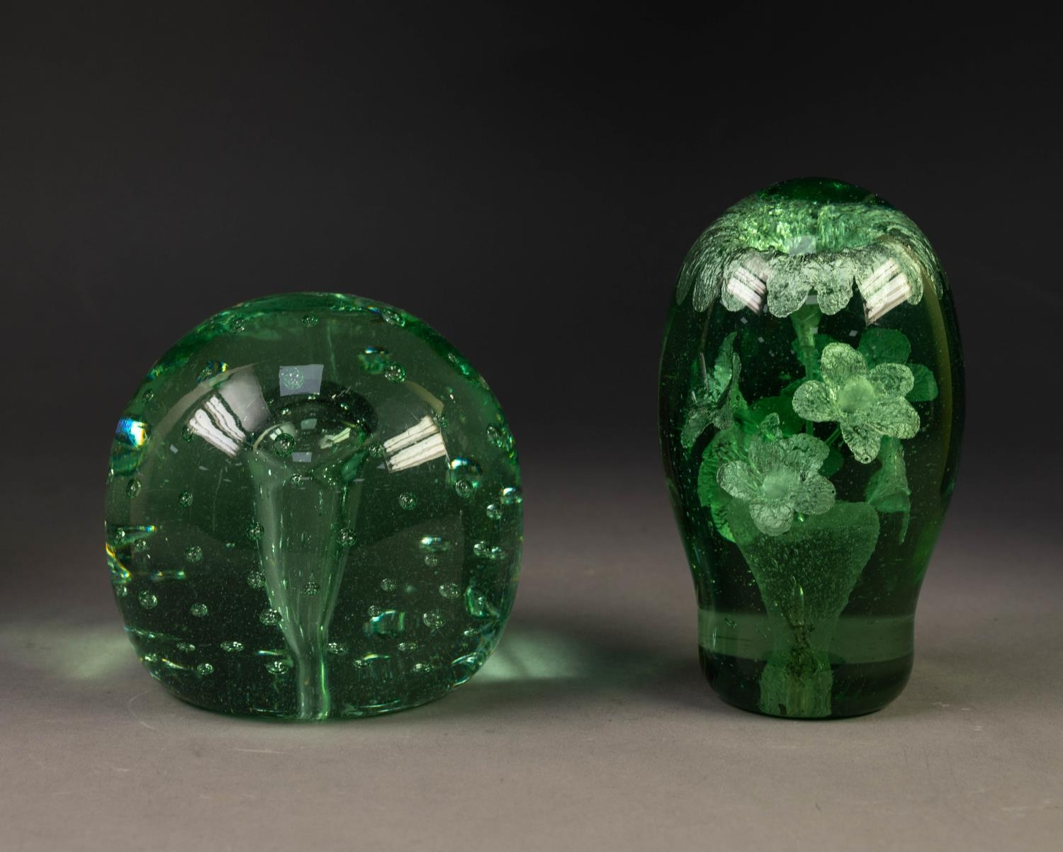 TWO NINETEENTH CENTURY GREEN GLASS DUMPS, one with bubble inclusions, 4 ½? (11.4cm) high, the