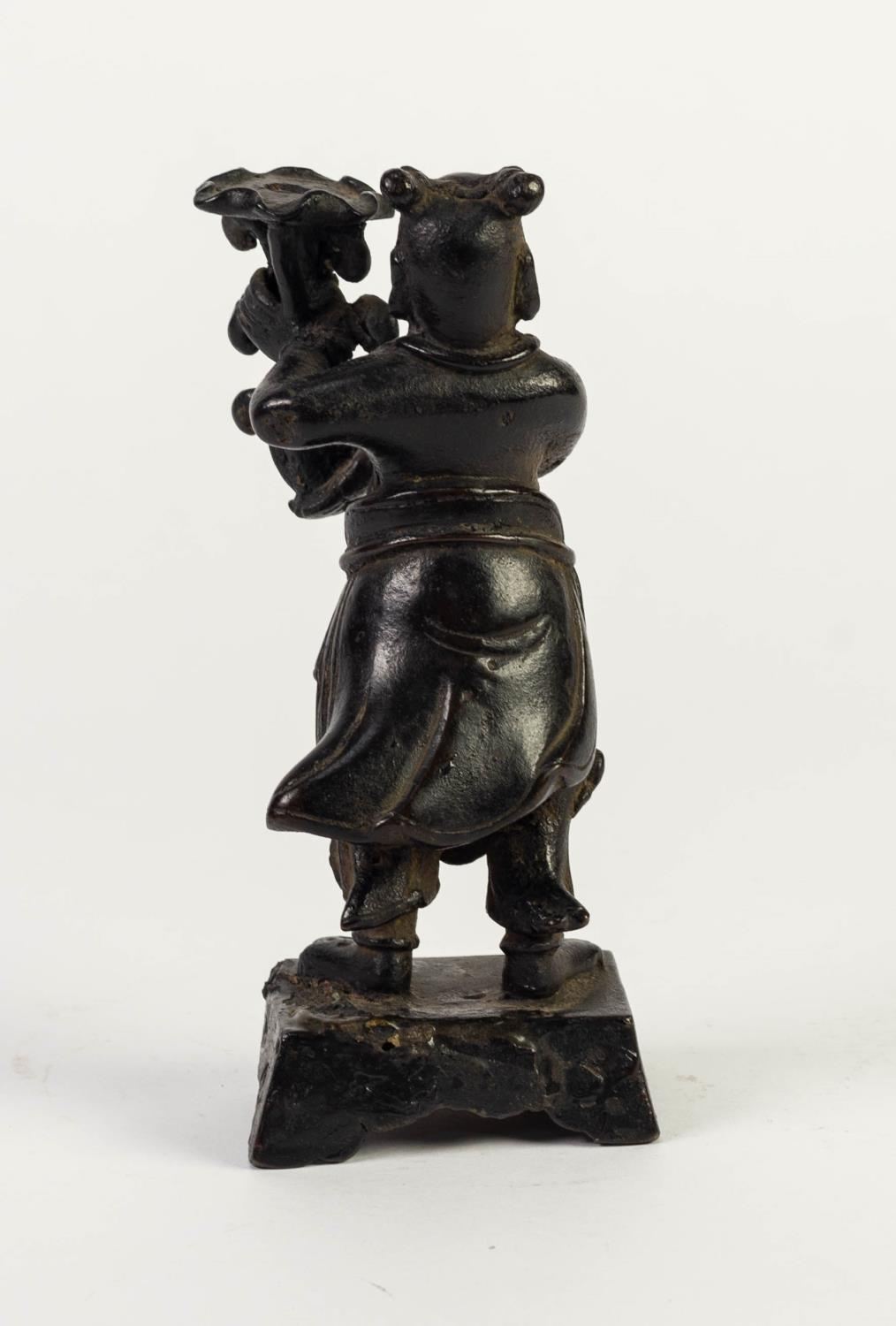 ANTIQUE CHINESE PATINATED BRONZE FIGURAL CANDLESTICK, modelled as a robed figure holding a floral - Image 2 of 2