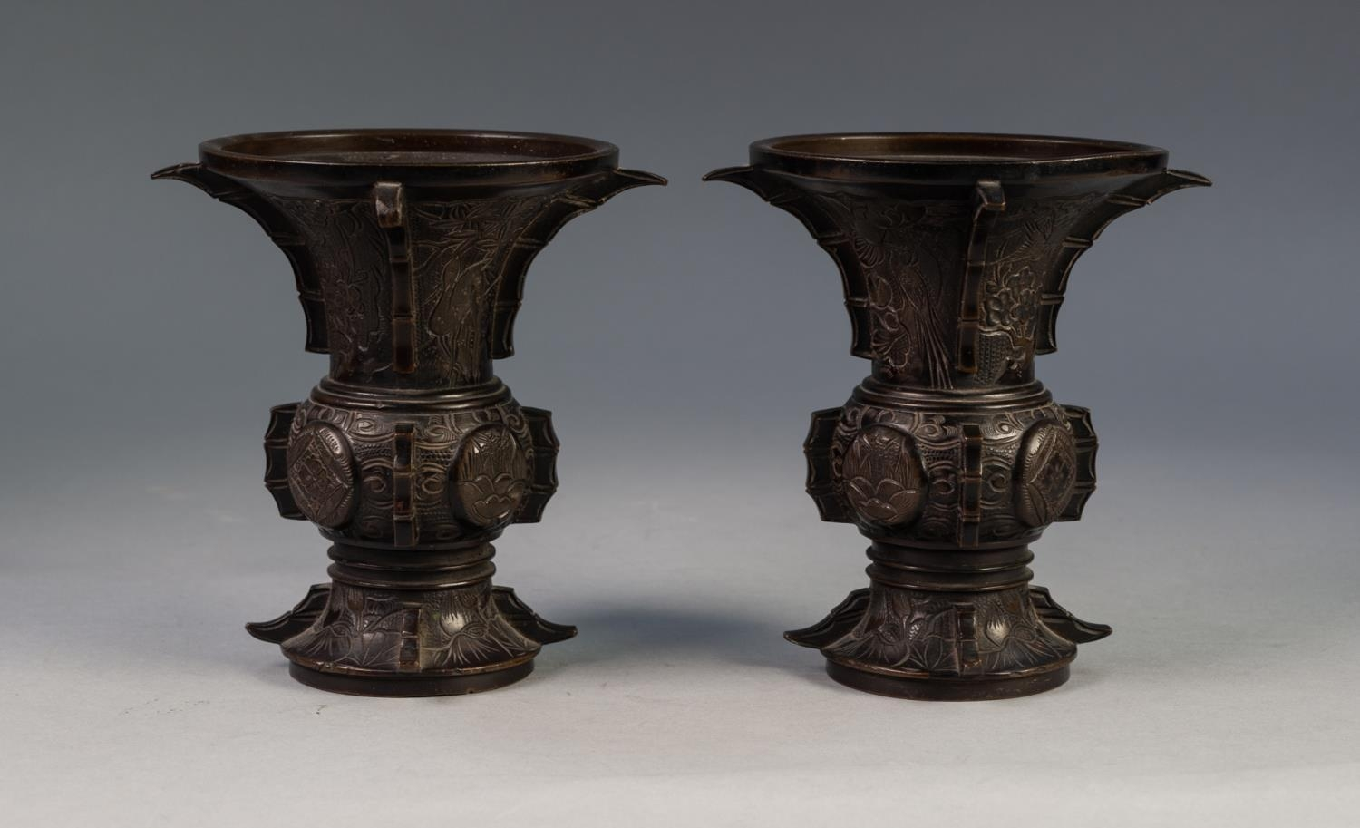 PAIR OF JAPANESE LATE MEIJI PERIOD BRONZE VASES, each of flared form, engraved with panels - Image 2 of 4