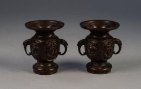 PAIR OF JAPANESE MEIJI PERIOD TWO HANDLED BRONZE SMALL VASES, each of footed form with flared rim