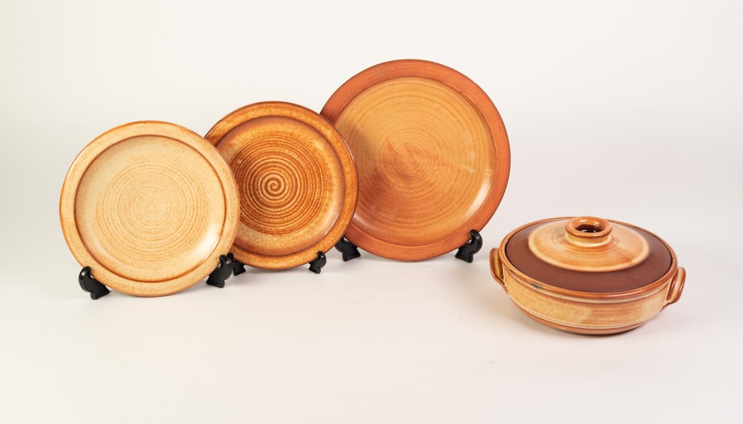 TWENTY ONE DAVID LEACH STYLE POTTERY PLATES IN FOUR SIZES, each with unglazed rims and slightly - Image 2 of 2