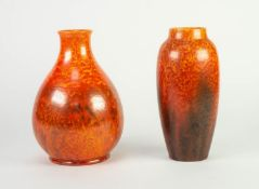 TWO ROYAL LANCASTRIAN ORANGE VERMILLION GLAZED POTTERY VASES, one of footed, baluster form, 9 ½? (