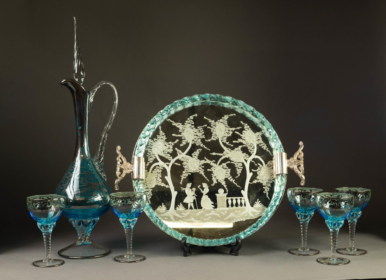 VINTAGE VENETIAN GLASS DRINKS SET comprising a circular tray with trailed blue tinted glass rope-