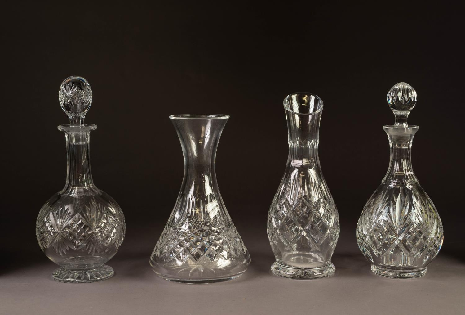 TWO CUT GLASS DECANTERS, with stoppers and TWO CUT GLASS WINE CARAFES (4)