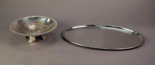 AN ELECTROPLATE PLANNISHED CIRCULAR FRUIT BOWL, with egg and dark border and raised on four large