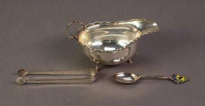 SILVER OVAL SAUCE BOAT, with castellated border, free scroll handle, raised on three hoof feet,