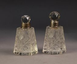 GEORGE V PAIR OF CUT GLASS SCENT BOTTLES WITH STOPPERS AND SILVER COLLARS, each of tapering