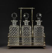 INTER-WAR YEARS ELECTROPLATED DECANTER STAND, with three well-cut square decanters, with carrying