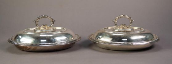 A PAIR OF ELECTROPLATE OVAL ENTREE DISHES AND COVER, with removable handles with beaded borders ,